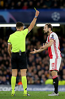 Daley Blind of Ajax receives a yellow card from match referee. Gianluca Rocchi after a challenge on Chelsea's Mateo Kovacic during Chelsea vs AFC Ajax, UEFA Champions League Football at Stamford Bridge on 5th November 2019