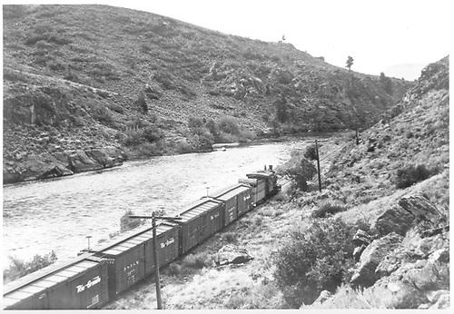 268 pulling box cars along Gunnison River.<br /> D&amp;RGW  Sapinero, CO  Taken by Krause, John - 9/1953