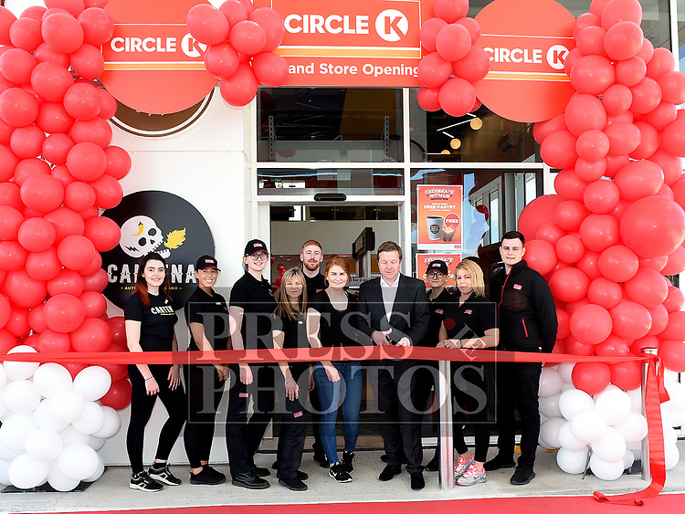 RTE Sports presenter Darragh Maloney cuts the ribbon to officially open Circle K at City North pictured with Regional Manager Natasha Fox, Manager Elaine Brennan and staff. Photo:Colin Bell/pressphotos.ie