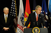 Arlington, VA - May 10, 2007 -- United States President George W. Bush makes a statement to reporters about the war in Iraq, after his meeting with senior national defense leaders at the Pentagon on Thursday, May 10, 2007.  At left is United States Secretary of Defense Robert Gates.<br /> Credit: D. Myles Cullen - DoD via CNP