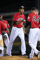 Hickory Crawdads relief pitcher Kelvin Vasquez (13) hands the ball to manager Corey Ragsdale (24) as he is removed from the game against the Charleston RiverDogs at L.P. Frans Stadium on August 25, 2015 in Hickory, North Carolina.  The Crawdads defeated the RiverDogs 7-4.  (Brian Westerholt/Four Seam Images)