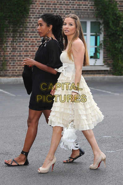 ELEN RIVAS .Attending The Grand Prix Ball at The Hurlingham Club, London, England, .UK, 7th July 2010. .full length strapless cream beige ruffles tiered ruffle bow peep toe shoes yellow bracelets christian louboutin walking side .CAP/WIZ.© Wizard/Capital Pictures.