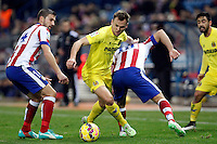 Gabi and Arda Turan of Atletico de Madrid and Cheryshev of Villarreal during La Liga match between Atletico de Madrid and Villarreal at Vicente Calderon stadium in Madrid, Spain. December 14, 2014. (ALTERPHOTOS/Caro Marin) /NortePhoto