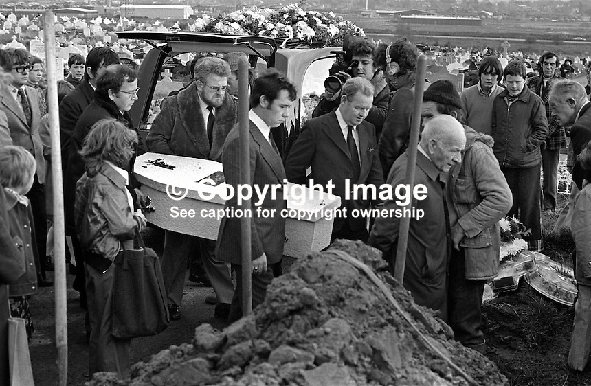 The little white coffin of Eileen Kelly, 6 years, arrives at the graveside in Milltown Cemetery. Her father is side on to the camera and wearing a pin-striped suit. Eileen died, 30th October 1975, in a Provisional IRA gun atttack targeting her father who was described as a Republican Clubs sympathiser. The Republican Clubs organization is the political wing of the Official IRA. The funeral was on 3rd November 1975. 197511030711b..Copyright Image from Victor Patterson, 54 Dorchester Park, Belfast, United Kingdom, UK...For my Terms and Conditions of Use go to http://www.victorpatterson.com/Victor_Patterson/Terms_%26_Conditions.html