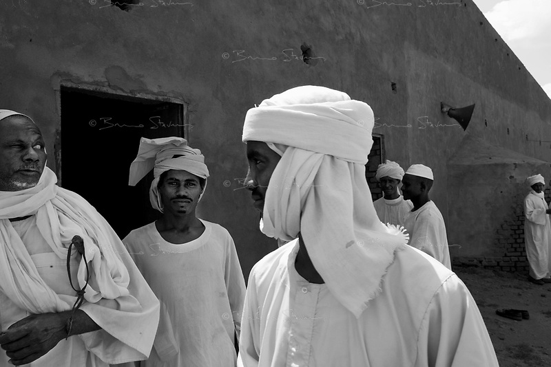 Mastariya, North Darfur, August 13, 2004.Saluz (second from left) and Daoud (center), two Janjaweed after their Friday prayer. Men from this village are Arabs from the Rezeghat tribe, most of them are enlisted in Janjaweed militia after Musa Hillal, their Sheikh, gave full support to the Khartoum government allegedly to fight the SLA rebels.