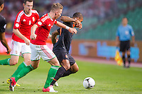 Hungary's Balazs Dzsudzsak (C) and Netherlands' Jeremain Lens (R) fight for the ball during a World Cup 2014 qualifying soccer match Hungary playing against Netherlands in Budapest, Hungary on September 11, 2012. ATTILA VOLGYI