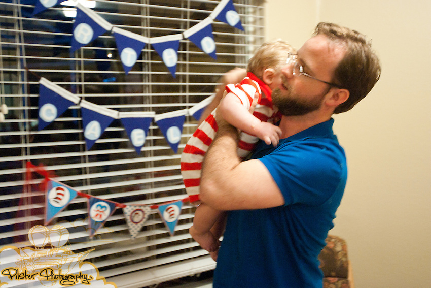 Caelum Anderson celebrates his first birthday Saturday, February 5, 2011, at his grandparents home in the Dr. Phillips neighborhood in Orlando, Florida. They had a Dr. Seuss birthday for him with a Cat in the Hat and many cool little details. He is the son of Joanna Anderson and Eric Anderson. (Chad Pilster, PilsterPhotography.net)