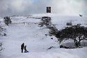 21/02/15  <br /> <br /> After heavy snow showers across the Derbyshire Peak District, sledgers brave the cold at Solomon's Temple, also known as Grinlow Tower, near Buxton.<br /> <br /> All Rights Reserved - F Stop Press.  www.fstoppress.com. Tel: +44 (0)1335 418629 +44(0)7765 242650