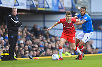 Jake Hessenthaler of Gillingham holds off Anton Walkes of Portsmouth as Portsmouth Manager Kenny Jackett left looks on during Portsmouth vs Gillingham, Sky Bet EFL League 1 Football at Fratton Park on 10th March 2018