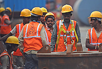 Workers with Hi Vis vests and helmets at the construction site in Madras, India