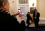 Bob O'Neil takes photos of Meilien Pinion and Jose Davalos with Nevada Gov. Steve Sisolak's portrait at the Capitol, in Carson City, Nev., on Monday, Jan. 7, 2019. (Cathleen Allison/Las Vegas Review-Journal)