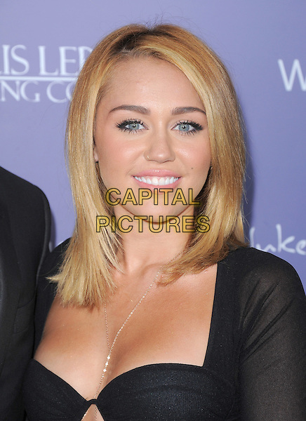 Miley Cyrus.Australians in Film 8th Annual Breakthrough Awards held at The Hotel Intercontinental in Century City, California, USA..June 27th, 2012  .headshot portrait black cleavage nose ring piercing                                                                      .CAP/RKE/DVS.©DVS/RockinExposures/Capital Pictures.