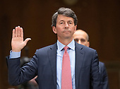 """Mark W. Begor, Chief Executive Officer, Equifax, Inc. is sworn-in to testify before the United States Senate Committee on Homeland Security and Governmental Affairs Permanent Subcommittee on Investigations during a hearing on """"Examining Private Sector Data Breaches"""" on Capitol Hill in Washington, DC on Thursday, March 7, 2019.<br /> Credit: Ron Sachs / CNP"""