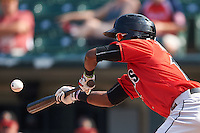 Indianapolis Indians second baseman Alen Hanson (13) lays down a bunt during a game against the Rochester Red Wings on June 10, 2015 at Frontier Field in Rochester, New York.  Indianapolis defeated Rochester 5-3.  (Mike Janes/Four Seam Images)