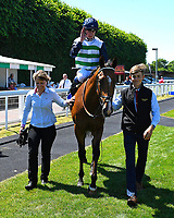 Winner of The Whitsbury Manor Stud British EBF Blagrave Maiden Stakes Forseti ridden by Oisin Murphy and trained by Andrew Balding is led into the winners enclosure  during Whitsbury Manor Stud Bibury Cup Day Racing at Salisbury Racecourse on 27th June 2018