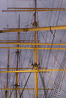 Detail of Masts and Rigging on the early 20th Century Four Masted Sailing Ship Peking Illuminated at Dusk, South Street Seaport, Lower Manhattan, New York City, New York State, USA.<br />