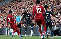 Manchester City's Benjamin Mendy controls under pressure from Liverpool's Roberto Firmino<br /> <br /> Photographer Rich Linley/CameraSport<br /> <br /> The Premier League - Liverpool v Manchester City - Sunday 7th October 2018 - Anfield - Liverpool<br /> <br /> World Copyright &copy; 2018 CameraSport. All rights reserved. 43 Linden Ave. Countesthorpe. Leicester. England. LE8 5PG - Tel: +44 (0) 116 277 4147 - admin@camerasport.com - www.camerasport.com