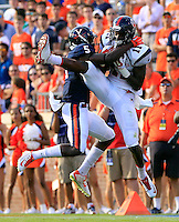 Richmond wide receiver Reggie Diggs (11) makes catch next to Virginia cornerback Tim Harris (5) during the game Saturday Sept. 6, 2014 at Scott Stadium in Charlottesville, VA. Virginia defeated Richmond 45-13. Photo/Andrew Shurtleff