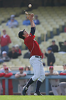 Kyle Barraclough #34 of the St.Mary's Gaels catches a pop up while pitching against the Georgia Bulldogs at Dodger Stadium in Los Angeles,California on March 13, 2011. Photo by Larry Goren/Four Seam Images