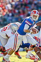 January 02, 2012:   Florida Gators quarterback John Brantley (12) drops back to pass during first half action at the 2012 Taxslayer.com Gator Bowl between the Florida Gators and the Ohio State Buckeyes at EverBank Field in Jacksonville, Florida.