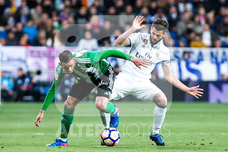Antonio Sarabia of Real Betis competes for the ball with Nacho Fernandez of Real Madrid during the match of Spanish La Liga between Real Madrid and Real Betis at  Santiago Bernabeu Stadium in Madrid, Spain. March 12, 2017. (ALTERPHOTOS / Rodrigo Jimenez)