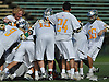 LIU Post men's lacrosse teammates celebrate after their 12-11 win over New York Institute of Technology in the ECC Championship at LIU Post on Saturday, May 7, 2016.