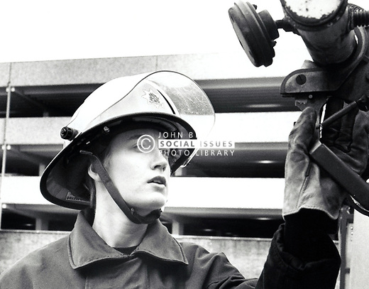 Female fire fighter, Beeston, UK 1980s