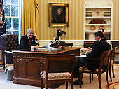 US President Donald Trump speaks with the King of Saudi Arabia, Salman bin Abd al-Aziz Al Saud in the Oval Office of the White House surrounded by  Senior Adviser to the President Jared Kushner (C), and Security Advisor Michael Flynn (R), January 29, 2017, Washington, DC. <br /> Credit: Aude Guerrucci / Pool via CNP