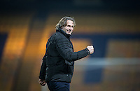 Wycombe Wanderers Manager Gareth Ainsworth punches the air as his team reach the semi final during the The Checkatrade Trophy  Quarter Final match between Mansfield Town and Wycombe Wanderers at the One Call Stadium, Mansfield, England on 24 January 2017. Photo by Andy Rowland.