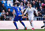 Lucas Vazquez (R) of Real Madrid competes for the ball with Ruben Duarte of Deportivo Alaves during the La Liga 2017-18 match between Real Madrid and Deportivo Alaves at Santiago Bernabeu Stadium on February 24 2018 in Madrid, Spain. Photo by Diego Souto / Power Sport Images
