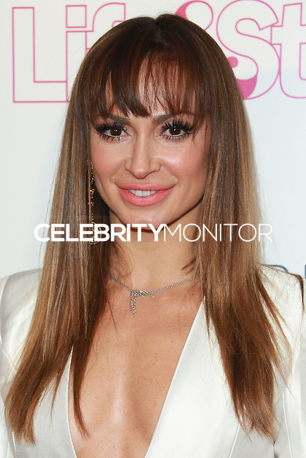 WEST HOLLYWOOD, CA, USA - OCTOBER 23: Karina Smirnoff arrives at the Life & Style Weekly 10 Year Anniversary Party held at SkyBar at the Mondrian Los Angeles on October 23, 2014 in West Hollywood, California, United States. (Photo by David Acosta/Celebrity Monitor)
