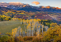 Uncompahgre National Forest, Colorado: Sunrise over the San Juan Range with fall colored aspens, scrub oaks and pines in the valley of East Dallas Creek