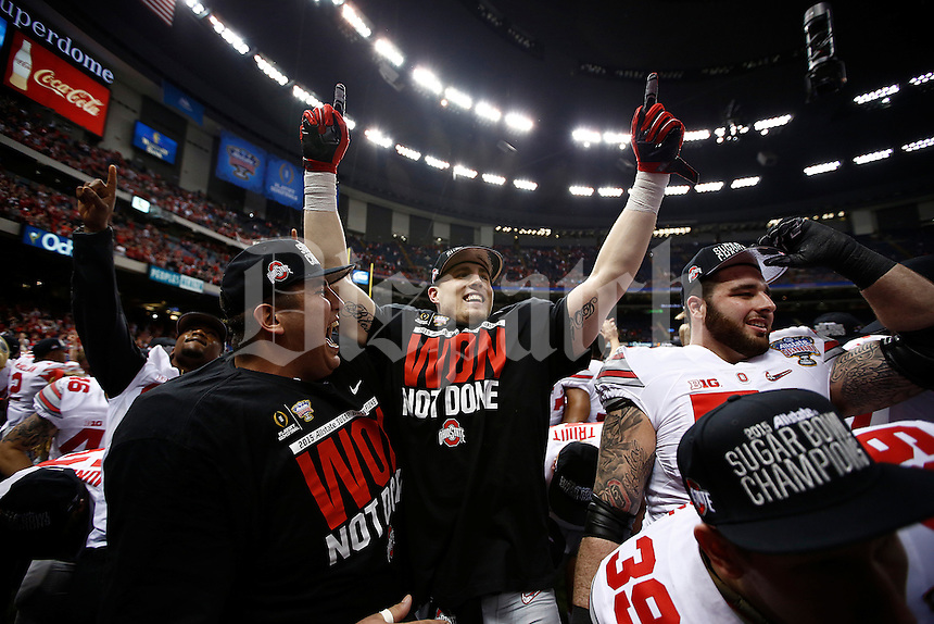 Ohio State Buckeyes tight end Jeff Heuerman (5), center, and his team mates celebrate after the Allstate Sugar Bowl and College Football Playoff Semifinal at Mercedes-Benz Superdome in New Orleans, Friday night, January 2, 2015. The Ohio State Buckeyes defeated the Alabama Crimson Tide 42 - 35. (The Columbus Dispatch / Eamon Queeney)