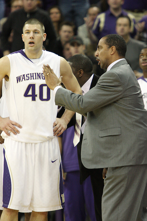 Jon Brockman, University of Washington senior, gets some advice from head coach  Lorenzo Romar during the Huskies Pac-10 conference showdown with arch-rival Washington State at Bank of America Arena in Seattle, Washington, on March 7, 2009.  The Huskies defeated the Cougars in a tight contest, 67-60