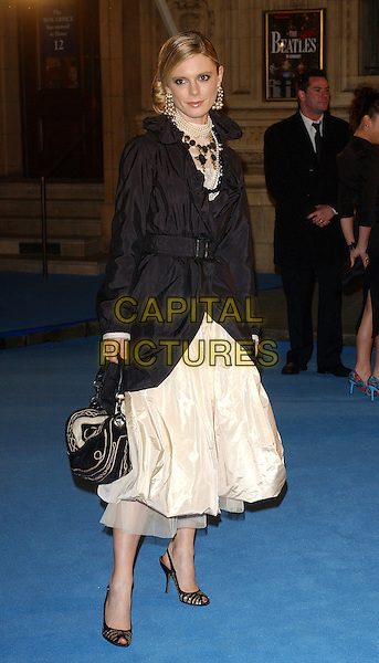 "EMILIA FOX.World Premiere of"" The Chronicles of Narnia: The Lion The Witch and The Wardrobe"" held at the Royal Albert Hall, London, UK..December 7th, 2005.Ref: BEL.Emillia Amelia full length pearl necklace ewhite skirt black coat jacket purse bag.www.capitalpictures.com.sales@capitalpictures.com.© Capital Pictures."