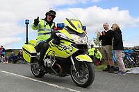 Picture by Thomas Gadd - 05/07/2014 - Cycling - Tour de France 2014 Grand Depart - Stage 1, Leeds to Harrogate - Yorkshire, England - MOTO Police bike outrider during Stage 1 of the Tour de France's Grand Depart. COPYRIGHT WARNING : THIS IMAGE IS RIGHTS MANAGED AND THE COPYRIGHT MAY SIT WITH A THIRD PARTY PLEASE CONTACT simon@swpix.com BEFORE DOWNLOAD AND OR USE Cycling fans spectators