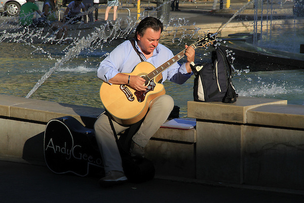 Guitarist street performer in downtown Milan, Italy.
