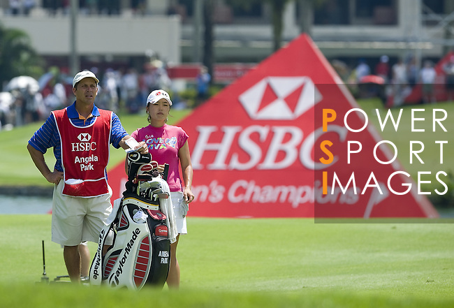 SINGAPORE - MARCH 06:  Angela Park of Brazil waits for a shot on the 17th hole during the second round of HSBC Women's Champions at the Tanah Merah Country Club on March 6, 2009 in Singapore.  Photo by Victor Fraile / The Power of Sport Images