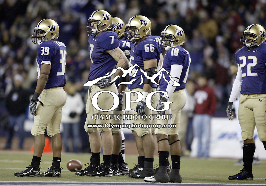 NOV 23, 2007:  Washington defenive players wait for the defensive play to be signaled in against Washington State.  Washington State won 45-35 over the Washington Huskies at the University of Washington Saturday during the 100th annual Apple Cup in Seattle, WA.