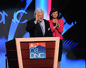 "Denver, CO - August 25, 2008 -- United States Senator Edward M. ""Ted"" Kennedy (Democrat of Massachusetts makes a speech on day 1 of the 2008 Democratic National Convention at the Pepsi Center in Denver, Colorado on Monday, August 25, 2008.  His wife, Victoria Reggie Kennedy, applauds from the right..Credit: Ron Sachs - CNP.(RESTRICTION: NO New York or New Jersey Newspapers or newspapers within a 75 mile radius of New York City)"