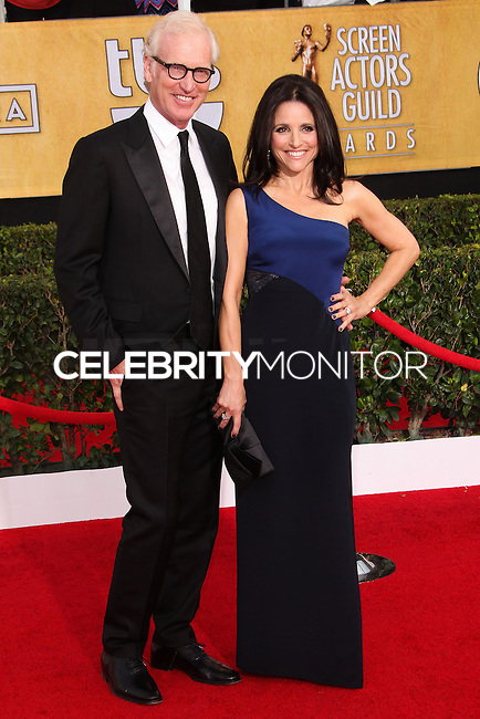 LOS ANGELES, CA - JANUARY 18: Brad Hall, Julia Louis-Dreyfus at the 20th Annual Screen Actors Guild Awards held at The Shrine Auditorium on January 18, 2014 in Los Angeles, California. (Photo by Xavier Collin/Celebrity Monitor)