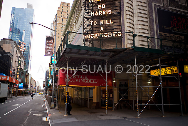 New York, New York<br /> March 20, 2020<br /> 5:10 PM<br /> <br /> Manhattan under the coronavirus pandemic. <br /> <br /> Broadway plays shut down in Manhattan due the fear of spring the virus.<br /> <br /> Normally this street would be filled with cars and people.