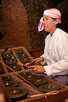 Myanmar, Burma. Bagan.  Burmese Musician Playing Brass Gong (Maung Saing).