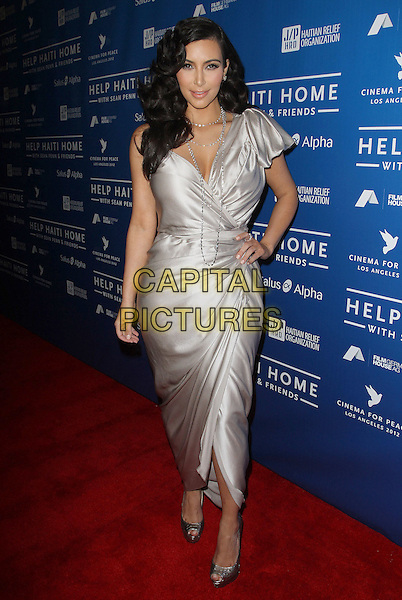 Kim Kardashian.Sean Penn And Friends Cinema For Peace Event Benefiting J/P Haitian Relief Organization held at the Montage Hotel, Beverly Hills, California, USA..January 14th, 2012  .full length silver dress hand on hip silk satin wrap.CAP/ADM/KB.©Kevan Brooks/AdMedia/Capital Pictures.