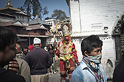 A Hindu man is dressed as Hanuman (monkey god) and seen begging outside the Pashupathi Nath Temple in capital Kathmandu, Nepal