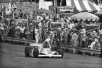 Bobby Rahal scrambles from his car after a fire started following a pit stop in the 1982 IndyCar race at Phoenix International Raceway near Phoenix, Arizona.
