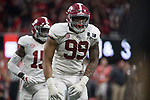 ATLANTA, GA - JANUARY 08: Raekwon Davis #99 of the Alabama Crimson Tide celebrates a stop on defense against the Georgia Bulldogs during the College Football Playoff National Championship held at Mercedes-Benz Stadium on January 8, 2018 in Atlanta, Georgia. Alabama defeated Georgia 26-23 for the national title. (Photo by Jamie Schwaberow/Getty Images)