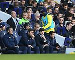 Tottenham's Emmanuel Adebayor warms up as a substitute behind manager Mauricio Pochettino<br /> <br /> - Barclays Premier League - Tottenham Hotspur vs Stoke City- White Hart Lane - London - England - 9th November 2014  - Picture David Klein/Sportimage