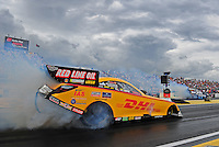 Mar. 9, 2012; Gainesville, FL, USA; NHRA funny car driver Jeff Arend burns out alongside Matt Hagan during qualifying for the Gatornationals at Auto Plus Raceway at Gainesville. Mandatory Credit: Mark J. Rebilas-