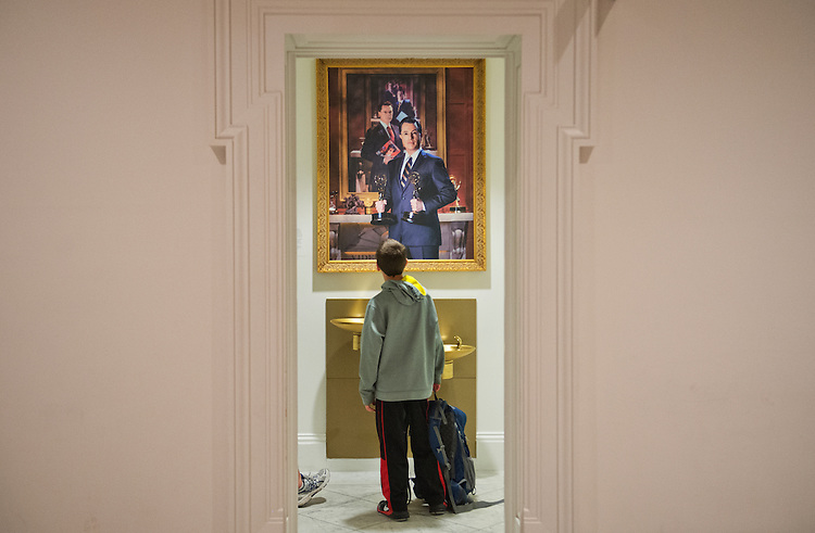 UNITED STATES - APRIL 10: Tim La Valley, 10, of Wisconsin, checks out a portrait of Stephen Colbert that is on display at the National Portrait Gallery, April 10, 2015. The painting is to be on display through April 19. (Photo By Tom Williams/CQ Roll Call)